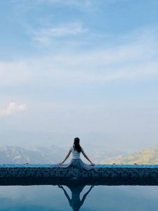 woman sitting on pool gutter