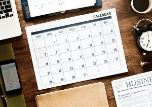 31-days calendar near round white analog alarm clock
